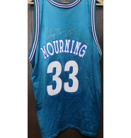 Mourning, Alonzo (Charlotte Hornets) Signed authentic Charlotte Hornets jersey size 48 on the back in silver ink.