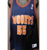 Mutombo, Dikembe (Denver Nuggets) Signed authentic Denver Nuggets jersey size 48 on the front in gold ink.