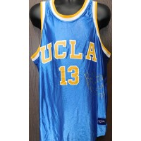 Walton, Bill (UCLA Bruins) Signed replica UCLA Bruins jersey size xl on the front in silver ink.