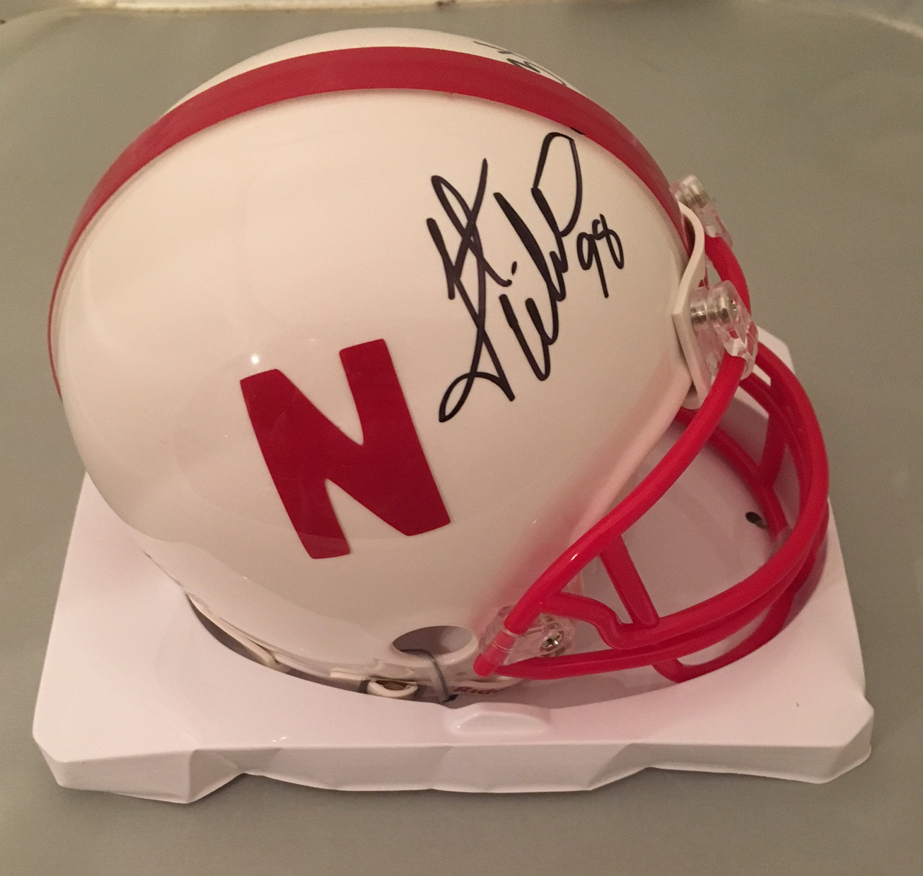 Grant Wistrom Autographed Nebraska Signed White Football Mini Helmet 3 X CHAMPS 2 Former Nebraska 3 x NCAA Champion and College Football Hall of Famer Grant Wistrom has signed this officially licensed Nebraska mini helmet and written 3 x NATL CHAMP. Autographed on 9/29/17. Item will come with a photo of Grant signing this type of item and a COA from Powers Sports Memorabilia who conducted the signing.  You will receive EXACT item shown.