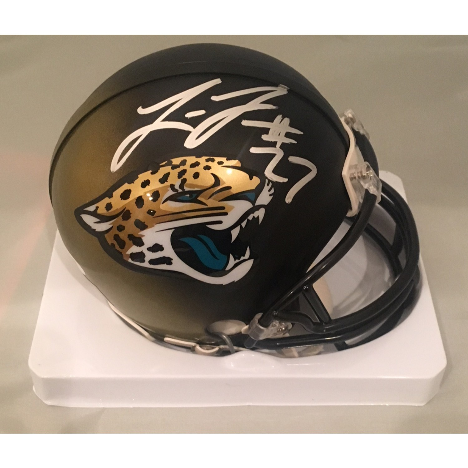 Leonard Fournette Autographed Jaguars Football Mini Helmet PSA DNA COA Star running back of the Jacksonville Jaguars Leonard Fournette has signed this officially licensed Jaguars mini helmet.  Autograph is authenticated by PSA/DNA, the world's leading authenticator of sports autographs. Comes with their unique sticker # fixed to the item and verified on their website. Also, comes with their certificate of authenticity with same matching #.