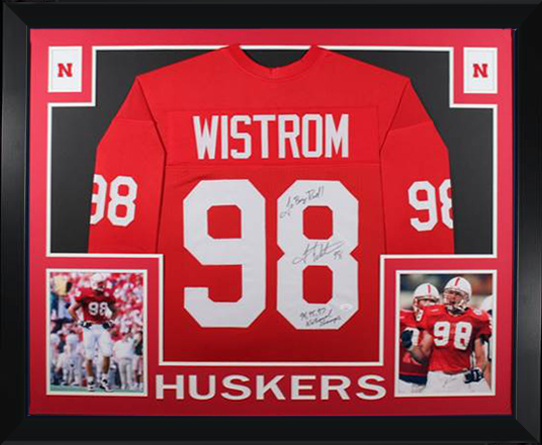 Grant Wistrom Autographed Nebraska Signed Football Stats Framed Jersey 94 95 97 NATL CHAMPS JSA COA Whoa!!! Talk about a Nebraska autographed collectible. This is it! Grant Wistrom one of Nebraska's best players of all-time has autographed this jersey and written  94 95 97 NATIONAL CHAMPS and GO BIG RED! If you are a Husker collector do not miss out on this item! This jersey has no tags no logos and no emblems. This is a custom made; no brand jersey with all stitched letters and numbers. All jerseys are size XL brand new and never worn. Autograph is authenticated by James Spence Authentication (JSA) the world�s leading authenticator of sports autographs. Comes with their unique sticker # fixed to the item and verified on their website. Also comes with their certificate of authenticity with same matching sticker #.  Comes framed as shown. Frame measures 35x43 and comes with UV plexi glass to protect your item. Receive exact item shown. Any glare in the image is just from the image being taken.